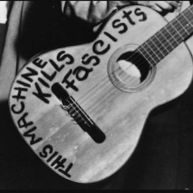 A cropped image of Woody Guthrie's guitar. Shared by a friend on facebook with the call to all artists to take a stand.